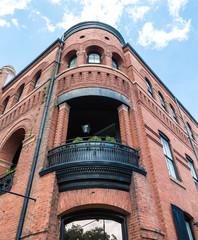 Black Iron Balcony on Old Brick Building