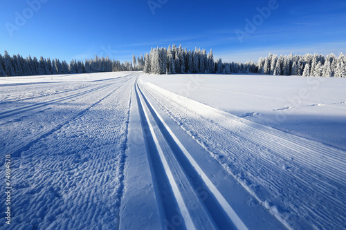 Foto op Canvas Heuvel Winter landscape and trails for skiers