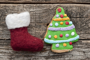 Santa or christmas boot on a wooden background for a greeting ca
