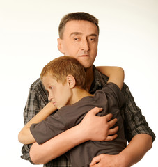 The ten years' son and father embrace each other