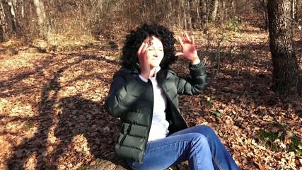 Beautiful Woman enjoying in forest in autumn