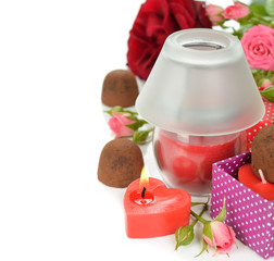 Chocolate truffles, candles and roses