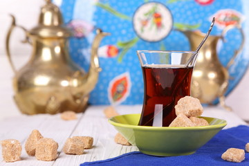 Turkish tea with cane sugar  on a white table