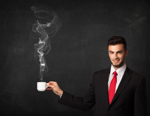 Businessman holding a white steamy cup