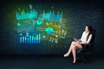 Businesswoman in office with tablet in hand and high tech graph