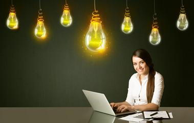 Businesswoman with idea bulbs