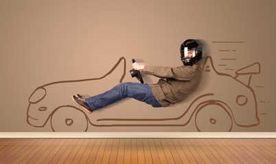 Happy man driving an hand drawn car on the wall