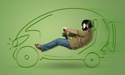 Man drives an eco friendy electric hand drawn car