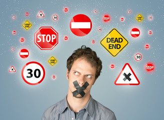 Young man with glued mouth and traffic signals