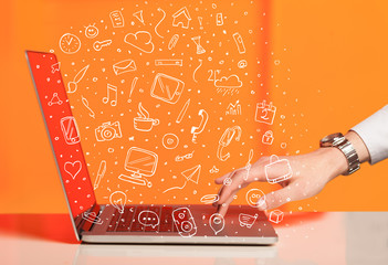 Laptop computer wtih hand drawn icons and symbols