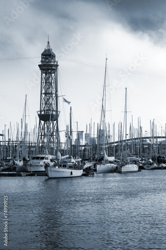 Port of Barcelona, Spain. Yachts, boats and old big tower - 74990923