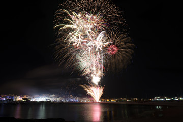 Colorful fireworks over sea