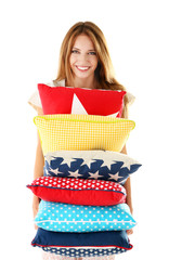 Beautiful young girl with pillows  isolated