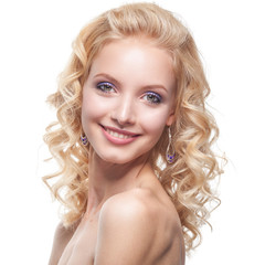 Young woman with curly blond hair and classy make up