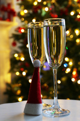 Two champagne glasses with red Santa hat