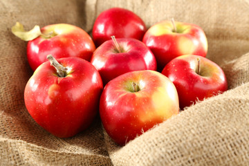 Heap of apples in burlap cloth background