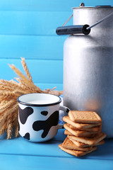 Retro can for milk, milk in cup, cookie and sheaf