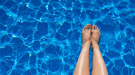 legs girl on a background of pool water