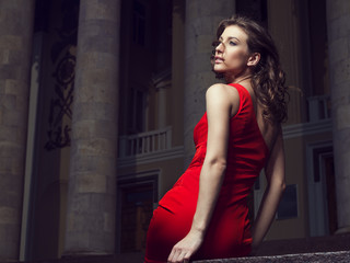 Fashion portrait of a stunning woman in red dress