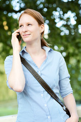 Woman on the Phone in a Park