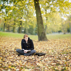 Woman Relaxing with a Book in a Park