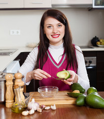 housewife cooking with avocado