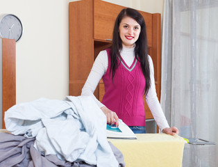 housewife ironing with iron