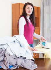 woman ironing at  home