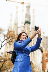 Woman with smartphone photographing