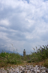 Dramatic cloudy sky over an old lighthouse, in Antirrio, Greece