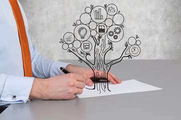 businessman drawing business tree