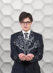 businessman holding tree
