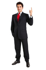 Smiling businessman pointing his finger up