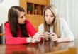 worried women with pregnancy test