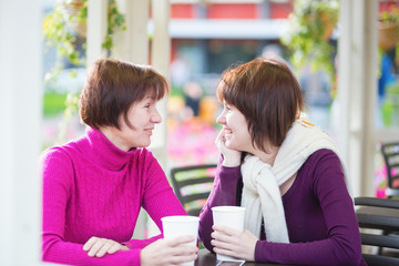 Mother and daughter together in cafe