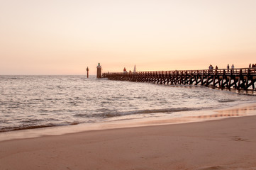 Sunset at Capbreton beach, France. Pier at dusk