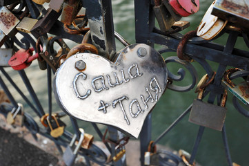 The couple hung a lock on the bridge railing