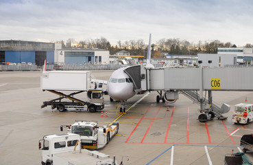passenger aircraft is in the Dusseldorf airport, Germany..