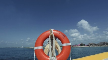 Shot of a lifesaver personal flotation device by the ocean water