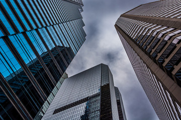Looking up at modern buildings under a cloudy sky in Philadelphi