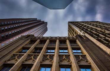 Looking up at tall buildings and a cloudy sky in Philadelphia, P
