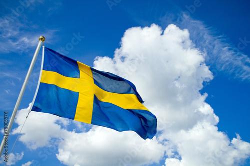 Fotobehang Noord Europa Swedish flag on blue summersky