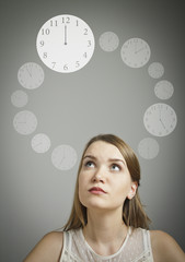 Girl in white and clock