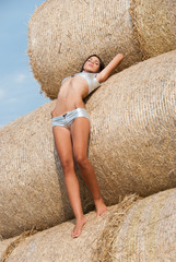 Woman, in sexy tight silver hot pants and top, at straw rolls