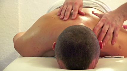 Therapist massaging a man