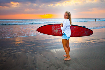 young girl with surfboard at the beach