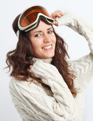 Portrait of young woman go in for winter sports over white backg