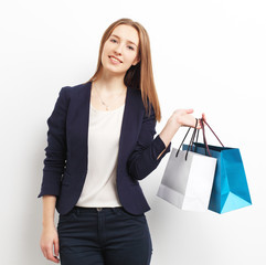 Image of businesswoman holding shopping bags, isolated on white
