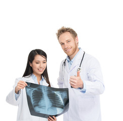 Caucasian male doctor and asian female assistant analysing patie
