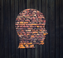 Silhouette of human head on the wall